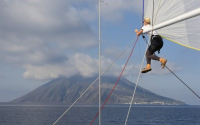 Capstan Sailing's bowgirl is performing a kite peel just off Stromboli. Our favourite photo!